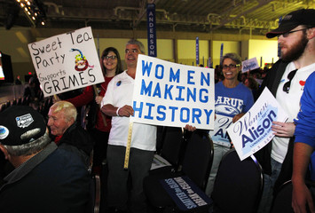 Campaign supports prepare for an event with Former U.S. Secretary of State Hillary Clinton and U.S. Democratic Senate candidate Alison Lundergan Grimes in Louisville