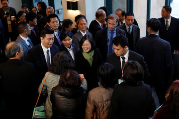 Taiwan President Tsai Ing-wen greets supporters as she leaves a hotel for her return to Taiwan after her visit to Latin America in Burlingame
