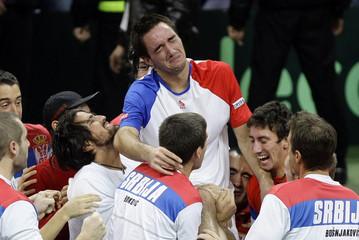 Serbia's Troicki celebrates victory over France's Llodra after their Davis Cup final tennis match in Belgrade