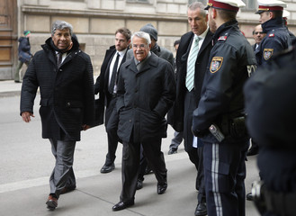 Saudi Arabia's Oil Minister al-Naimi is accompanied by security staff as he arrives for a meeting of OPEC oil ministers at OPEC's headquarters in Vienna