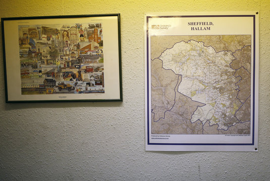 A map showing the boundaries of his Hallam constituency hangs on the wall of the constituency office of Britain's Deputy PM Clegg in Sheffield