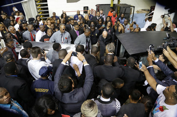 Mourners and family accompany Alton Sterling's casket at his funeral in in Baton Rouge