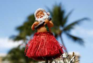 A Santa tree top ornament on Waikiki beach in  Hawaii