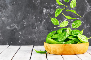 Falling fresh spinach leaves