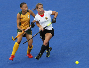 South Africa's Marais challenges Germany's Hahn during their women's Group B hockey match at the London 2012 Olympic Games at the Riverbank Arena on the Olympic Park