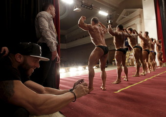 A man takes pictures during a regional bodybuilding and fitness competition in Stavropol