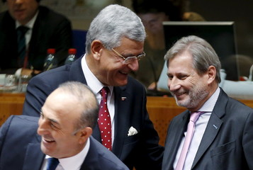 Turkey's EU Affairs Minister Bozkir greets EU Commissioner Hahn during a EU-Turkey accession conference in Brussels