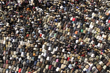 Opposition supporters attend Friday prayers in Tahrir Square in Cairo