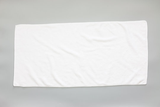 White towel on a gray background