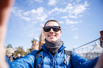 Cheerful man making selfie