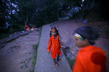 "Children on pilgrimage walk along the woods during the ""Bol Bom"" pilgrimage in Kathmandu"