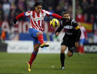 Atletico's Madrid Falcao controls the ball in front of Levante's Ballesteros during their Spanish first division soccer match in Madrid