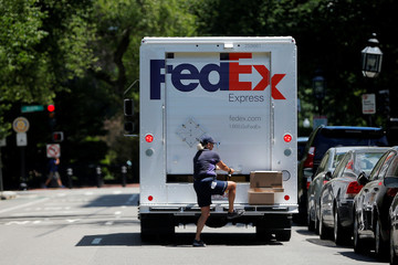 A Fedex driver delivers packages in Boston