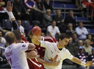 Denmark's Schmidt struggles with Slovakia's Rabek during their Men's European Handball Championship Group A match in Belgrade