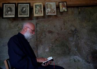 Hermit Vanuytrecht of Belgium prays in his hermitage in Saalfelden