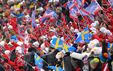 Norwegian and Swedish fans wave flags at the Nordic Ski World Championships in Tesero