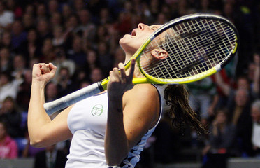 Vinci of Italy celebrates her victory over Goerges of Germany in their final match at the WTA tennis tournament in Luxembourg