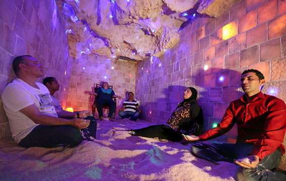 A group sits in the salt cave during a meditation session in Cairo