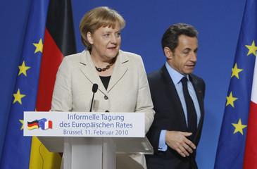 Germany's Chancellor Merkel and France's President Sarkozy address a news conference after an informal summit of EU heads of state and government in Brussels