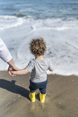 Toddler with his mom at the beach.