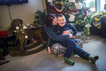 Evan Leversage, who is terminally ill with brain cancer, poses for a picture with his mother Nicole Wellwood in St. George