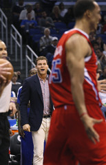 Los Angeles Clippers' Griffin yells encouragement to Hollins as they play Orlando Magic during their NBA basketball game in Orlando