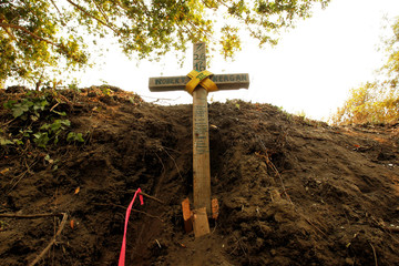 A cross is seen at the site where bulldozer operator Robert Reagan of Fresno County was killed in a rollover on July 26, 2016 while fighting the Soberanes Fire, in the Palo Colorado area north of Big Sur, California