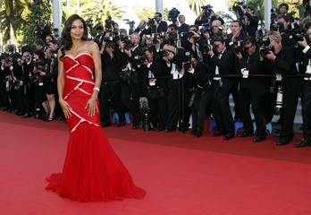 Actress Dawson arrives for the screening of the film This Must Be The Place at the 64th Cannes Film Festival