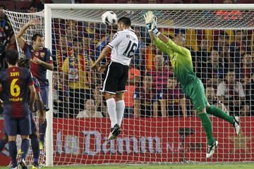 Barcelona's goalkeeper Valdes tries to block Valencia's Ruiz during their Spanish First division soccer league match at Camp Nou stadium in Barcelona