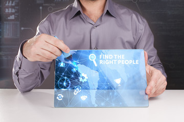Business, Technology, Internet and network concept. Young businessman working on a virtual screen of the future and sees the inscription: Find the right people