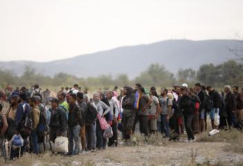 Migrants line-up at registration camp after crossing the Macedonian-Greek border near Gevgelija