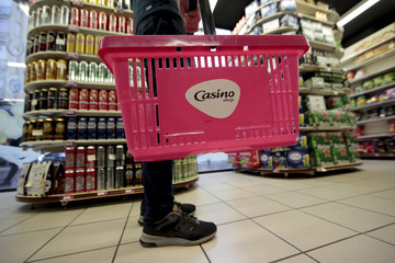 File photo of a customer holding a shopping basket inside a Casino shop in Nice