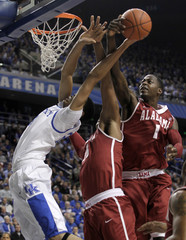 University of Kentucky's Anthony Davis fights for the rebound with the University of Alabama's Jamychal Green and Levi Randolph during the first half of play in their NCAA basketball game at Rupp Arena in Lexington