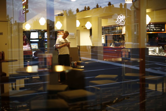 A customer is seen through the window of a pub in Geelong