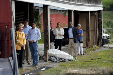 Democratic presidential candidate Hillary Clinton listens as she is introduced during a campaign stop at Beech Hill Farm in Hopkinton