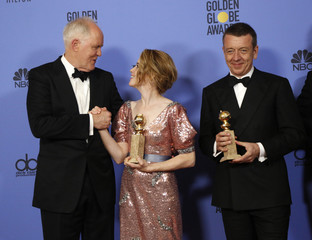 John Lithgow congratulates co-star Claire Foy during the 74th Annual Golden Globe Awards in Beverly Hills