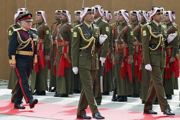 Jordan's King Abdullah reviews the honour guard before the opening of the third ordinary session of the 17th Parliament in Amman