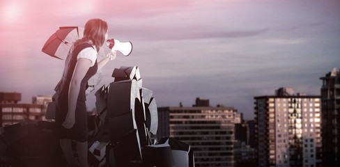 Composite image of businesswoman shouting through megaphone