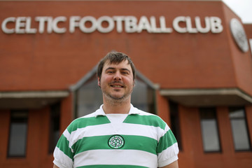 Celtic fan Paul McShane poses for a photograph outside Celtic Park Glasgow,Scotland