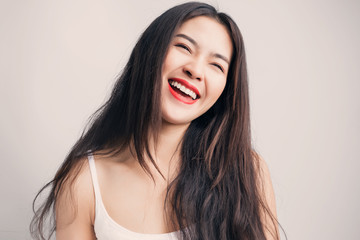 Young beautiful Asian woman with smiley face.