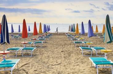 Running on the beach of Lignano Sabbiadoro, Italy