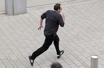 U.S. director Quentin Tarantino runs during an event at the 5th Lumiere Festival in Lyon