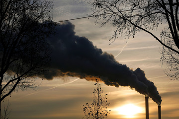 Water vapour billows from smokestacks at the incineration plant of Ivry-sur-Seine near Paris as the sun rises