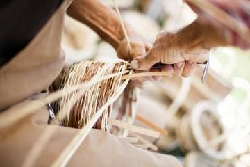 Artisan creates wicker baskets,  Italy