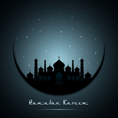 Ramadan Kareem beautiful greeting card with moon and silhouette mosque
