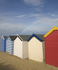 Beach huts with rainbow