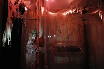 """An actor dressed as a ghost doctor inside a """"5D haunted house"""" at Hong Kong Ocean Park"""