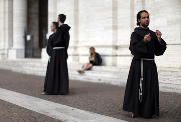 Franciscan friar Alessandro Brustenghi, 34, gestures as he speaks before his performance at the Santa Maria degli Angeli basilica in Assisi