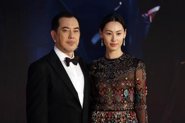 Hong Kong actress Leong and actor Wong pose on red carpet at Hong Kong Film Awards