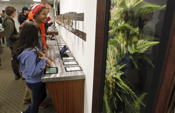 Buyers browse samples at Shango Cannabis shop on first day of legal recreational marijuana sales beginning at midnight in Portland, Oregon